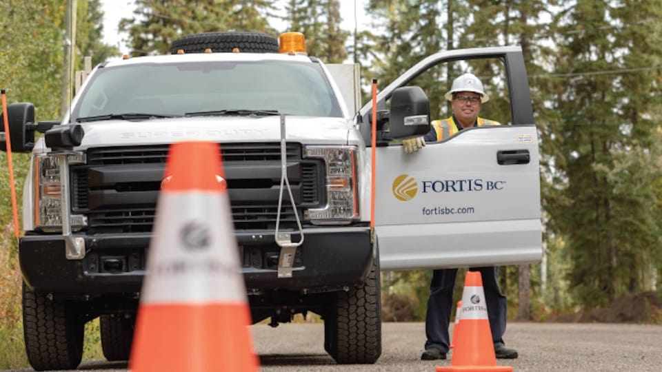 FortisBC worker in a work truck