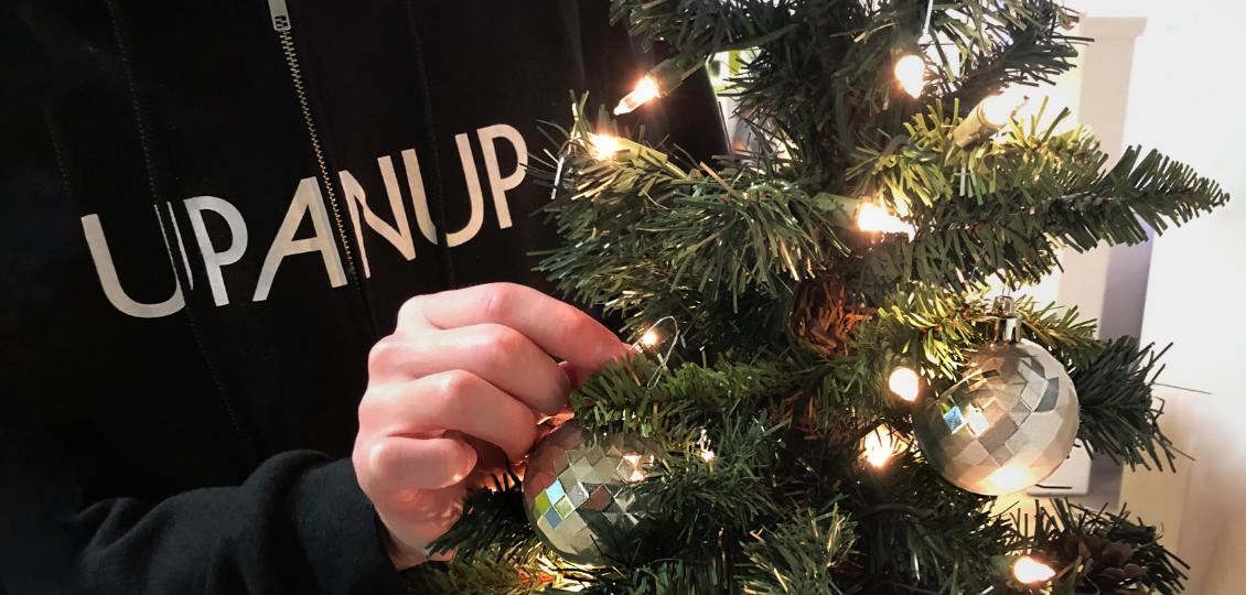Upanup team member decorating for the holidays